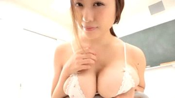 Adorable Asian whore shows off big natural tits in a lacy bra