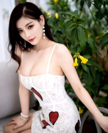 Beautiful Teasing Chinese Babe With Black Curly Hair White Lingerie