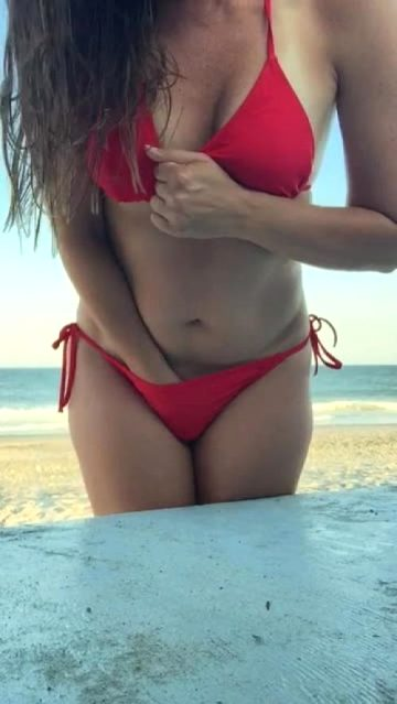 Hand In Her Bikini Then Having A Taste.