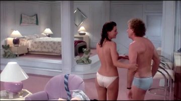 Kelly Le Brock Getting Into Bed In The Woman In Red