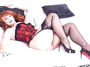 Redhead Milf fingers throbbing pussy in corset nylons heels