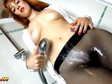 Redhead takes a shower and masturbates wearing black pantyho